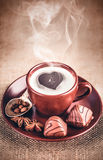 Cup fragrant hot coffee with bean chocolate Stock Photos