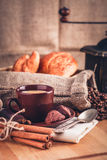 Cup fragrant hot coffee with bean chocolate. Sweet and loaf in vintage rustic style on wooden board for bracing morning breakfast Stock Photo