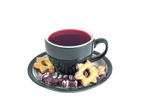 A cup of fragrant hot tea and delicious sweet biscuits  Stock Photo