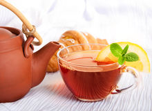 Cup of fragrant tea  from a ceramic teapot Stock Images