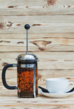 The cup and french press Stock Photos