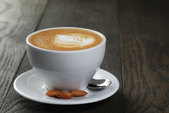 Cup of fresh cappuccino with latte art Royalty Free Stock Image