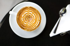 Cup of a fresh caramel latte coffee Stock Photography