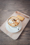 Cup of a fresh caramel latte with whipped cream,. Cup of a caramel latte with whipped cream Royalty Free Stock Image