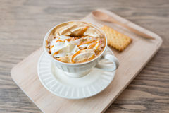 Cup of a fresh caramel latte with whipped cream,. Cup of a caramel latte with whipped cream Royalty Free Stock Photo