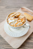 Cup of a fresh caramel latte with whipped cream,. Cup of a caramel latte with whipped cream Royalty Free Stock Images