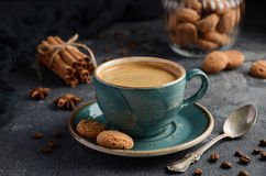 Cup of fresh coffee with Amaretti cookies on dark background stock photography