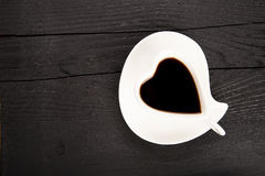 Cup of fresh coffee with heart sign Stock Image