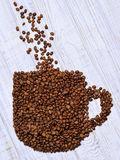 Cup of fresh coffee made of coffee beans  Stock Images