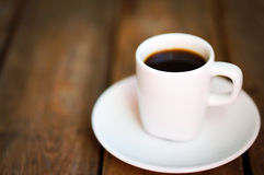 Cup of fresh coffee on rustic wooden background Royalty Free Stock Photography