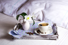 Cup of fresh coffee with white lily Royalty Free Stock Photo
