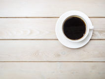 Cup of fresh Coffee on Wooden table Top view Stock Photos