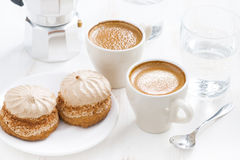 Cup of fresh espresso and cakes for breakfast on white table Stock Photos