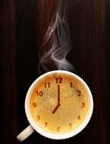 Cup of fresh espresso with clock Royalty Free Stock Image