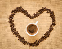 Cup of fresh espresso Coffee and beans Stock Images