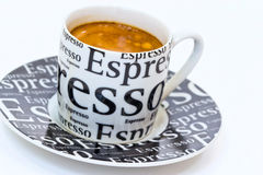 Cup fresh espresso coffee with gold crema. Cup fresh espresso coffee with crema on the black saucer Royalty Free Stock Photos
