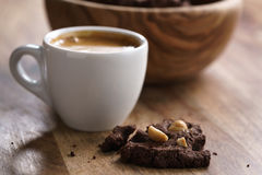 Cup of fresh espresso with homemade chocolate cookie with hazelnuts Royalty Free Stock Photos