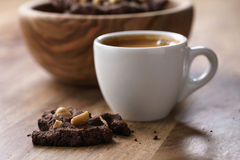 Cup of fresh espresso with homemade chocolate cookie with hazelnuts Stock Images