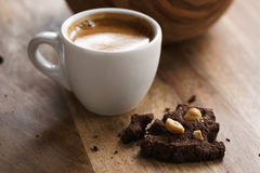Cup of fresh espresso with homemade chocolate cookie with hazelnuts Stock Image