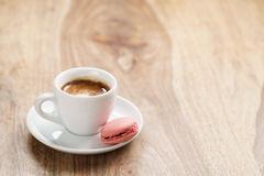 Cup of fresh espresso with macarons on wood table with copy space Stock Image