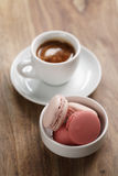 Cup of fresh espresso with macarons on wood table Stock Image