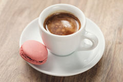 Cup of fresh espresso with macarons on wood table Royalty Free Stock Photo