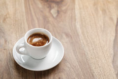Cup of fresh espresso on wood table with copy space Stock Photography