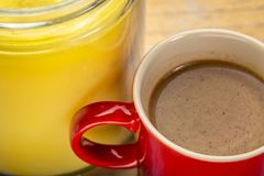 Cup of fresh fatty coffee with ghee royalty free stock image