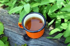 Cup of fresh herbal tea royalty free stock photo