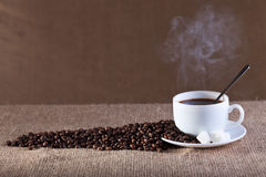 Cup of fresh and hot steaming coffee Stock Photography