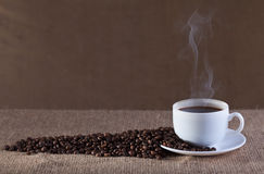 Cup of hot steaming coffee Royalty Free Stock Photo