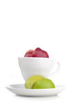 Cup of fresh juice with slice of apple inside Royalty Free Stock Photography