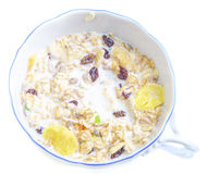 Cup with fresh milk,  flakes and dry fruits Stock Photos