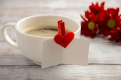 Cup of fresh morning coffee with Valentine`s day card. Royalty Free Stock Image