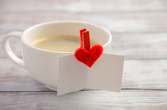 Cup of fresh morning coffee with Valentine`s day card Royalty Free Stock Image