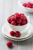 Cup of fresh raspberries. Fresh raspberries in a china cup Stock Photo
