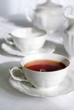 Cup of fresh and steaming tea. Stock Photo