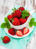 Cup with fresh strawberries Stock Images