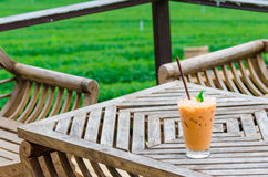Cup of fresh sweet tea background of tea plantations Royalty Free Stock Photos