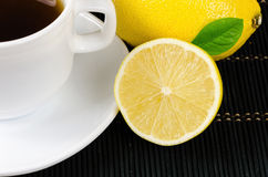 Cup of fresh tea with lemon on rustic wood background. Breakfast concept Royalty Free Stock Photos