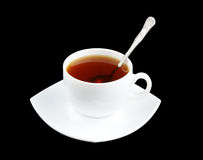 Cup of fresh tea with spoon and saucer isolated Stock Image