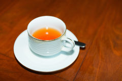 Cup of fresh tea on wooden table Stock Photography
