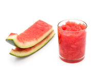 Cup of fresh watermelon juice and two finished skins. On white Royalty Free Stock Photos