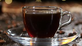 Cup of freshly brewed black coffee. Closeup side view stock video