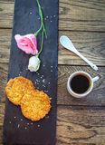 Cup of freshly brewed coffee, sesame cookies, pink lisianthus  flower Stock Photo