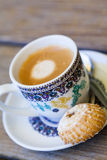 Cup of freshly brewed tea and a cookie Stock Photo