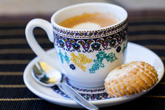 Cup of freshly brewed tea and a cookie Royalty Free Stock Photo