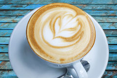 Cup of freshly made espresso in coffee shop on blue wood board Royalty Free Stock Photography