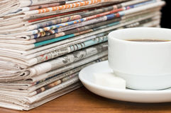 Cup From Coffee And The Newspaper Stock Images