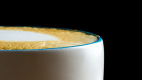 Cup of frothy cappuccino coffee Stock Images